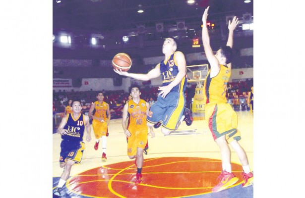 Pre-Season Action. The University of Cebu (in blue) and the University of San Jose-Recoletos (in yellow) will join three other college teams in the Cesafi pre-season tournament in Bogo City. (Sun.Star File)